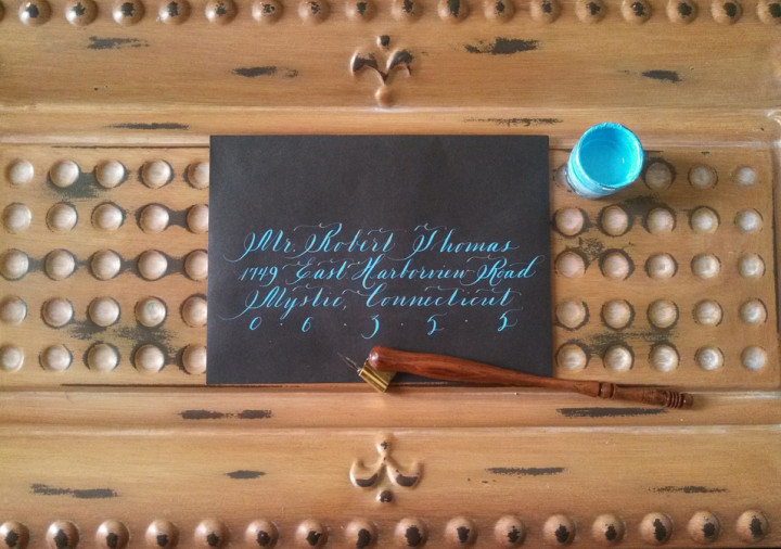 turquoise ink on black envelope - Bella Grafia Calligraphy